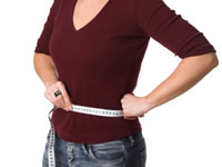 Use a tape measure to measure your waist