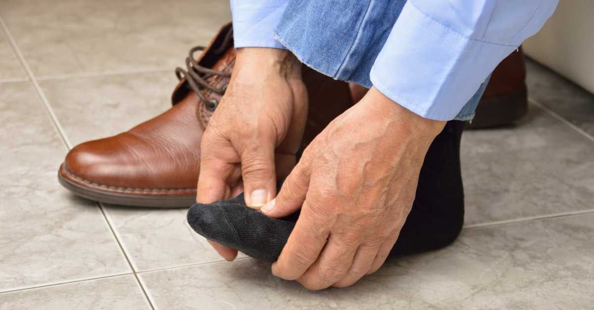 A man checks the health of his foot